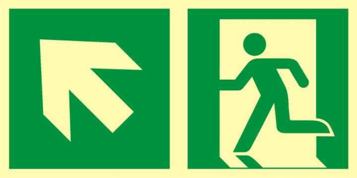 Znak ewakuacyjny Kierunek do wyjścia ewakuacyjnego - w górę w lewo