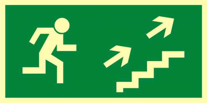 Znak ewakuacyjny Kierunek do wyjścia drogi ewakuacyjnej schodami w górę w prawo